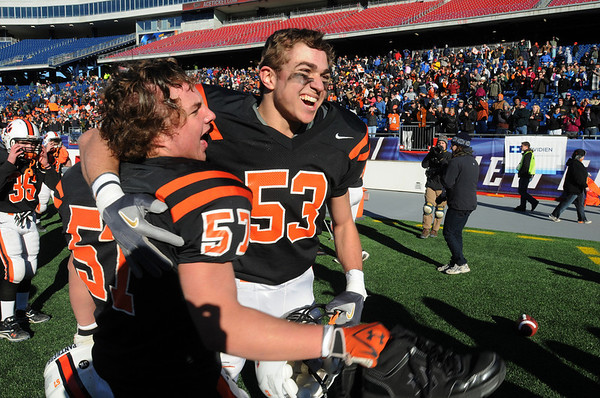 Beverly football players Marc Babcock, left, and Rob Cattell rejoice after Beverly won the Beverly vs Scituate in the Division 3 Super Bowl at Gillette Stadium. Photo by Ken Yuszkus/Salem News, Saturday, December 4, 2010.