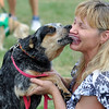 "Salem:  Linda St. Pierre of Peabody gets a slobbery kiss during the ""rock of love"" category of the Heritage Days Dog Show.  photo by Mark Teiwes / Salem News"