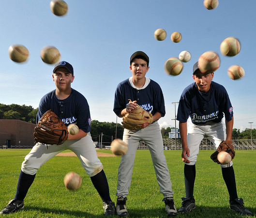 Danvers: Jordan Kost, left, Scott Marino, and JT Bisazza are key defensive players for the Danvers Babe Ruth baseball 14-year-old all-star team.   photo by Mark Teiwes / Salem News