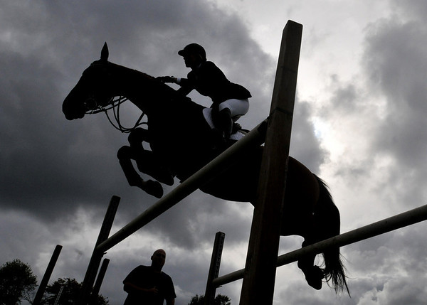 Hamilton: Equestrian Schuyler Riley clears a practice jump with her horse Lapacco before competing in the $30,000 class of the Putnam Boston Jumper Classic at the 110th Myopia Horse Show   photo by Mark Teiwes / Salem News