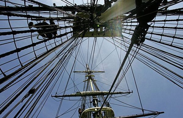 Seaman Jared Hutchins climbs his way up the ropes toward the sails while  aboard the Friendship. Naval officers, who will work aboard the USS Constitution, trained aboard the Friendship for three days. They had been doing dry dock training since May and this was their first chance to train at sea. Photo by Deborah Parker/July 14, 2010