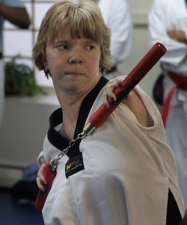 Peabody: Sheila Radziewicz  uses her nunchucks during a recent class at Bruce McCorry's Martial Arts School. Sheila is currently a brown belt. She was born with thrombocytopenia or TAR syndrome. Photo by Mark Lorenz/Salem News.
