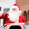 Beverly: Santa Claus waves to crowds of people lining Cabot St. in Beverly during the 66th annual Beverly Holiday Parade on Sunday afternoon. David Le/Salem News