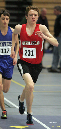 Ken Yuszkus/Staff photo: Danvers: Marblehead's A. J. Earnst leads the runners at the start of the mile race at the Marblehead at Danvers indoor track meet.