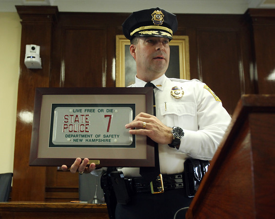 Beverly: Beverly Police Chief John LeLacheur explains the plaque he was given by New Hampshire State Police Captain Gary Wood during a swearing-in ceremony held at Beverly City Hall on Thursday afternoon. DAVID LE/Staff Photo