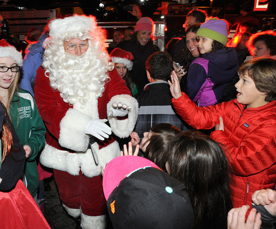 Ken Yuszkus/Staff photo. Salem: Santa makes his way through the crowd to get to the tree lighting in Salem Common.