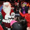 Ken Yuszkus/Staff photo. Salem: Santa makes his way through the crowd to get to the tree lighting in Salem Common.