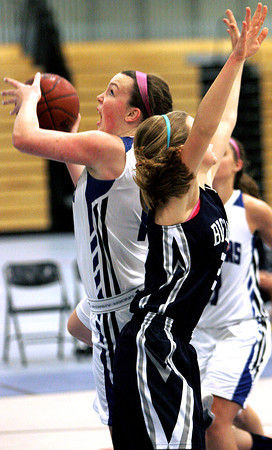 Ken Yuszkus/Staff photo: Danvers: Danvers' Emily McNulty fires for the hoop after losing Swampscott's Hannah Leahy during the Swampscott at Danvers girls basketball game.