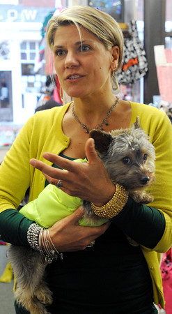 Ken Yuszkus/Staff photo. Karen Davis is the owner of Penelope's Pet Boutique in Salem. She is holding her dog George.