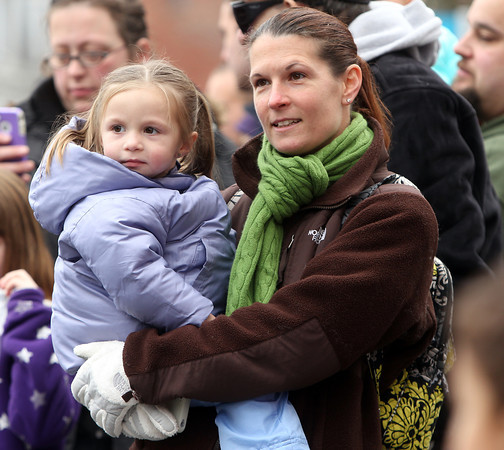 Beverly: Elaine Haight, of Beverly, holds her daughter Avery, 2, during the 66th annual Beverly Holiday Parade on Sunday afternoon. David Le/Salem News