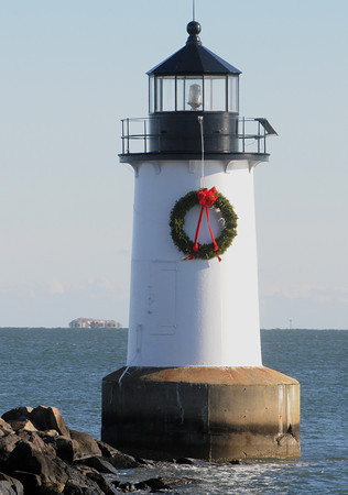 Ken Yuszkus/Staff photo: Salem: The Winter Island lighthouse now has a wreath.