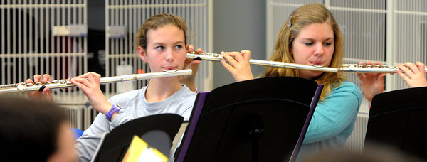 Ken Yuszkus/Staff photo: Danvers: Lindsay MacInnis, left, and Rebecca Cummings practice on their flutes during the Danvers High School Falcon Band practice. The band is heading off to the Magic Kingdom.