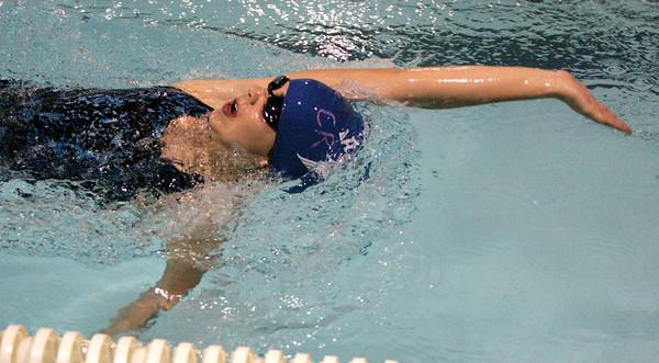 Ken Yuszkus/Staff photo. Danvers: Danvers' Raquel Leslie swims the 200 medley relay race during the Beverly at Danvers swim meet season opener.