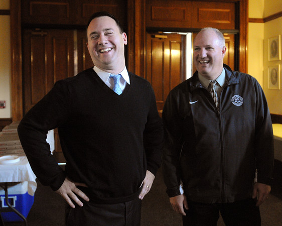 Ken Yuszkus/Staff photo: Peabody: Peabody Mayor Ted Bettencourt, left, laughs with coach Dave Woods while chatting before honoring the Division 5 Super Bowl winning Bishop Fenwick football team at Peabody City Hall.