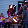 RYAN HUTTON/ Staff photo. Fire dancers entertain the crowd at the New Year's Eve celebration in downtown Beverly