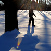 Ken Yuszkus/Staff photo: Danvers: Park Ranger Tyler Berry walks through the snow amongst the long winter shadows at Endicott Park in Danvers.