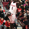 Ken Yuszkus/Staff photo: Salem:<br /> Salem's Rashad Keys shoots for a basket as Beverly's Jonangel Franco covers him during the Beverly at Salem boys basketball game.