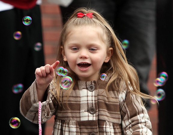 Beverly: Isabella Moore, 3, smiles while popping bubbles during the 66th annual Beverly Holiday Parade on Sunday afternoon. David Le/Salem News