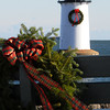 Ken Yuszkus/Staff photo: Salem: The Winter Island lighthouse now has a wreath. There are also wreaths placed on the park benches. One of which is in the foreground.