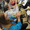 Ken Yuszkus/Staff photo: Danvers: From bottom, Taylor Purcell, Diana Silva, Johnathan Prideaux, and Adam Czubinski practice on their trumpets during the Danvers High School Falcon Band practice. The band is heading off to the Magic Kingdom.