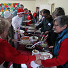 Danvers: Volunteers dish out Christmas dinner at the 32nd annual Christmas Dinner with Friends held at the North Shore Unitarian Universalist Church in Danvers on Wednesday afternoon. DAVID LE/Staff Photo
