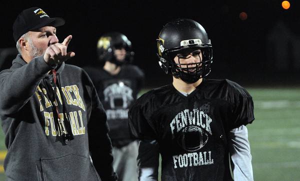 Peabody:<br /> With Nick Bona at his side, Coach Dave Woods gives instructions during the the Bishop Fenwick football team practice. They are getting ready for the Division 5 Super Bowl on Saturday.<br />  Photo by Ken Yuszkus / The Salem News, Monday, December 2, 2013.