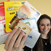 Salem:<br /> DCF intern Leighanne Souther of Peabody holds gift cards donated to help teens in the DCF system.<br />  Photo by Ken Yuszkus / The Salem News, Monday, December 2, 2013.