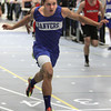 Ken Yuszkus/Staff photo: Danvers: Danvers' John Thomas crosses the finish line to won his heat in the 55 meter race at the Marblehead at Danvers indoor track meet.