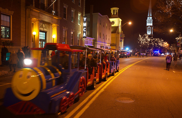 RYAN HUTTON/ Staff photo. The Roaming Railroad takes families up and down Cabot Street at the New Year's Eve celebration in downtown Beverly