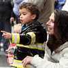 Beverly: Michael Bruce, 3, of Essex, points out the Shriners mini trucks to his aunt, Jessie Bruce, during the 66th annual Beverly Holiday Parade on Sunday afternoon. David Le/Salem News
