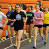 Beverly:<br /> Spring sprint captains Caytlin Harty, left, and Kristin O'Connor lead the group of girls during practice on the first day of girls indoor track.<br />  Photo by Ken Yuszkus / The Salem News, Monday, December 2, 2013.