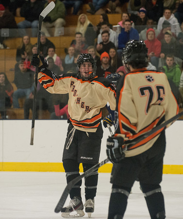 DESI SMITH Staff photo. Beverly's Clinton Cabral celebrates a goal with teamate Tyler Cloutman in the second period against Essex Hornets at the Dorothy Talbot Rink Friday night in Gloucester.