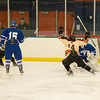 Desi Smith Staff photo/Salem News. Beverly's Jake Straw #14 celebrates Kevin Lally #3 (left) goal against Danvers goalie Alex Taylor Saturday afternoon at Rockett Arena at Salem State University in Salem. December 21,2013