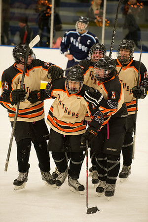 DESI SMITH Staff photo. Beverly's Jake Straw is congratulated by his teammates after his goal against Peabody at Salem State University's Rockett Arena in Salem Saturday afternoon. December 14,2013