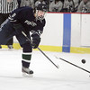 Ken Yuszkus/Staff photo. Hamilton: Pingree's Maxx Trotsky shoots toward the net during the Moses Brown School at Pingree hockey opener.