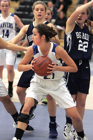 Ken Yuszkus/Staff photo: Danvers: Danvers' Allison Walsh looks for a teammate to pass to during the Swampscott at Danvers girls basketball game.