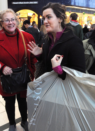 Ken Yuszkus/Staff photo: Peabody: Katie Collins, right, of Italy, but originally from Gloucester, with her mother, Kathlyn Valianti of Gloucester, speak about shopping at the Northshore Mall the day after Christmas.