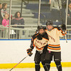 Desi Smith Staff photo/Salem News. Beverly's #22 Connor Irving (left) celebrates his goal with his teammate Saturday afternoon at Rockett Arena at Salem State University in Salem. December 21,2013