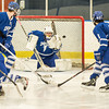 Desi Smith Staff photo/Salem News. Danvers goalie Alex Taylor just missed gloving a shot by Beverly's Kevin Lally as it hit the back of the net  Saturday afternoon at Rockett Arena at Salem State University in Salem. December 21,2013