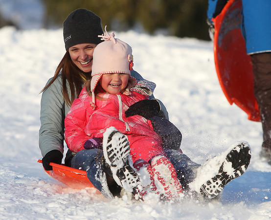 Beverly: Addison McCafferty, 4, of Beverly, laughs while sliding down the hill at Lynch Park in Beverly with her mom Laurel on Wednesday afternoon. DAVID LE/Staff Photo