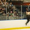 Desi Smith Staff photo/Salem News. Beverly's Kevin Lally leeps up into the glass after scoring against Danvers goalie Alex Taylor Saturday afternoon at Rockett Arena at Salem State University in Salem. December 21,2013