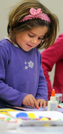 Ken Yuszkus/Staff photo: Hamilton:<br /> Asa Labell, 5, of Hamilton, makes a treasure box during a children's crafts program at the Hamilton-Wenham Public Library on Friday afternoon.