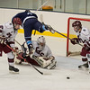 Desi Smith Staff photo/Gloucester Daily Times. Peabody's Reed Foster goes flying over Gloucester's Goalie Owen Parisi head trying to score in the second period Saturday night at the Dorothy Talbot Rink in Gloucester.  December 21,2013