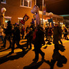 RYAN HUTTON/ Staff photo. The Grand Procession heads down Cabot Street at the New Year's Eve celebration in downtown Beverly