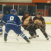 Desi Smith Staff photo/Salem News. Beverly's Connor Irving looks to move past Danvers Alex Littlefield Saturday afternoon at Rockett Arena at Salem State University in Salem. December 21,2013