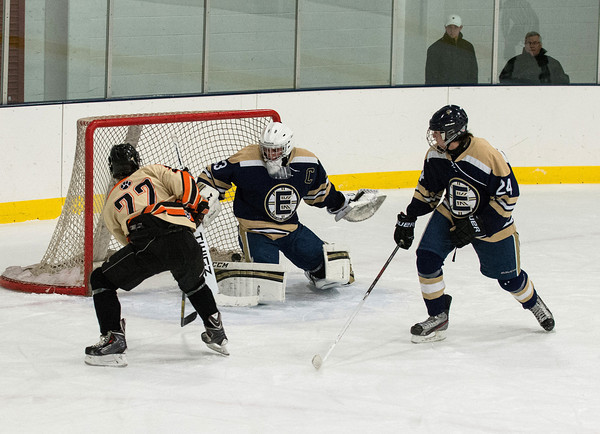 DESI SMITH Staff photo. Beverly's Connor Irving puts one past Essex Hornet's Goalie Brock Paquette in the first period at the Dorothy Talbot Rink Friday night in Gloucester.