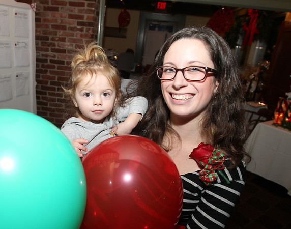 Salem: Ward 2 Councilor Heather Famico poses for a photo with Fiona Macione, 1 1/2, at the 20th annual Salem Children's Charity party held at Victoria's Station in Salem on Tuesday evening. DAVID LE/Staff Photo