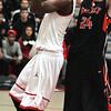 Ken Yuszkus/Staff photo: Salem:<br /> Salem's Rashad Keys shoots for a basket as Beverly's Nicholas Cross covers him during the Beverly at Salem boys basketball game.