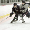 Ken Yuszkus/Staff photo. Hamilton: Pingree's Christopher Usseglio gets a shove toward the boards by a Moses Brown player during the Moses Brown School at Pingree hockey opener.