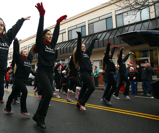 Beverly: Dancers from the North Shore Dance Academy dance down Cabot St. during the 66th annual Beverly Holiday Parade on Sunday afternoon. David Le/Salem News